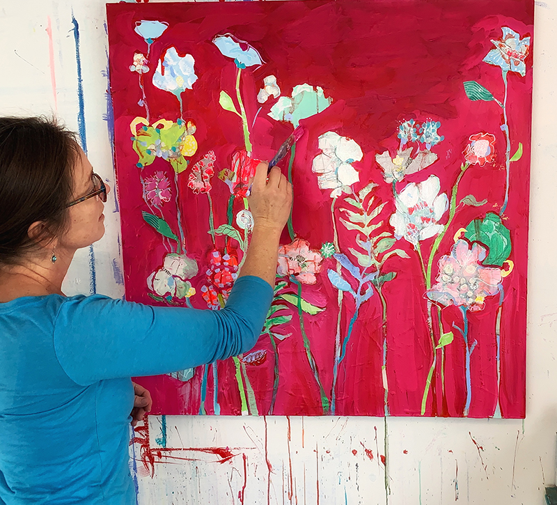 Kellie Day painting a floral