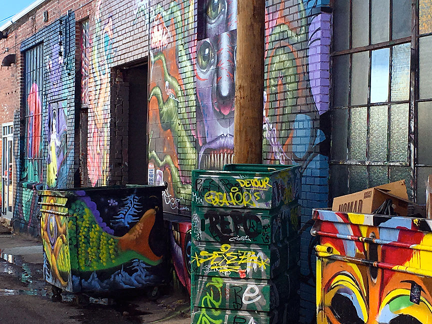 Alley art with matching dumpsters