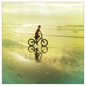 My son Chente, beach biking at Kiawah, SC